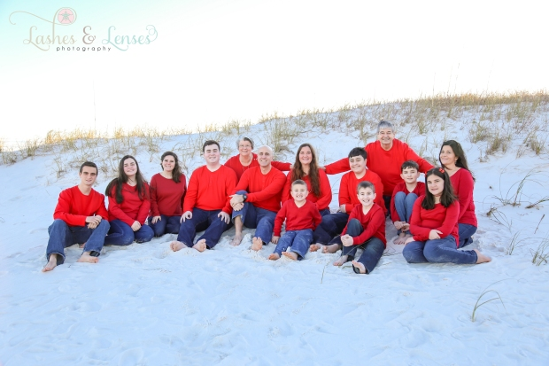 Large extended family sitting in the sand at Johnsons Beach in Perdido Key