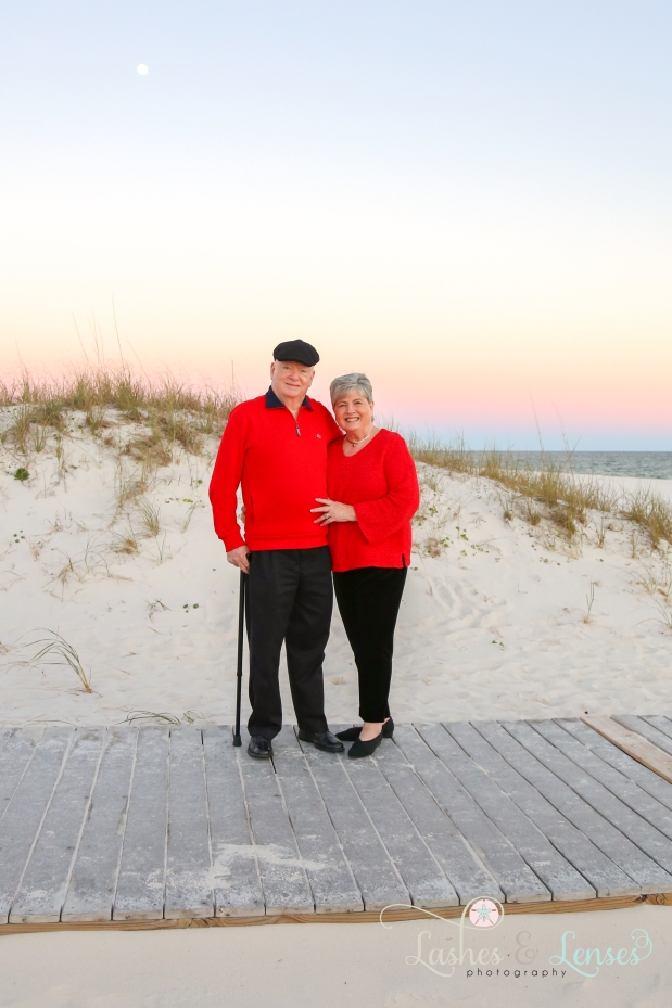 Mature couple standing on the boardwalk at Johnsons Beach in Perdido Key