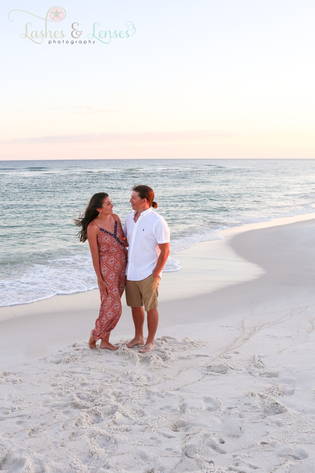 Husband and Wife staring into each others eyes next to the water at Johnsons Beach in Perdido Key
