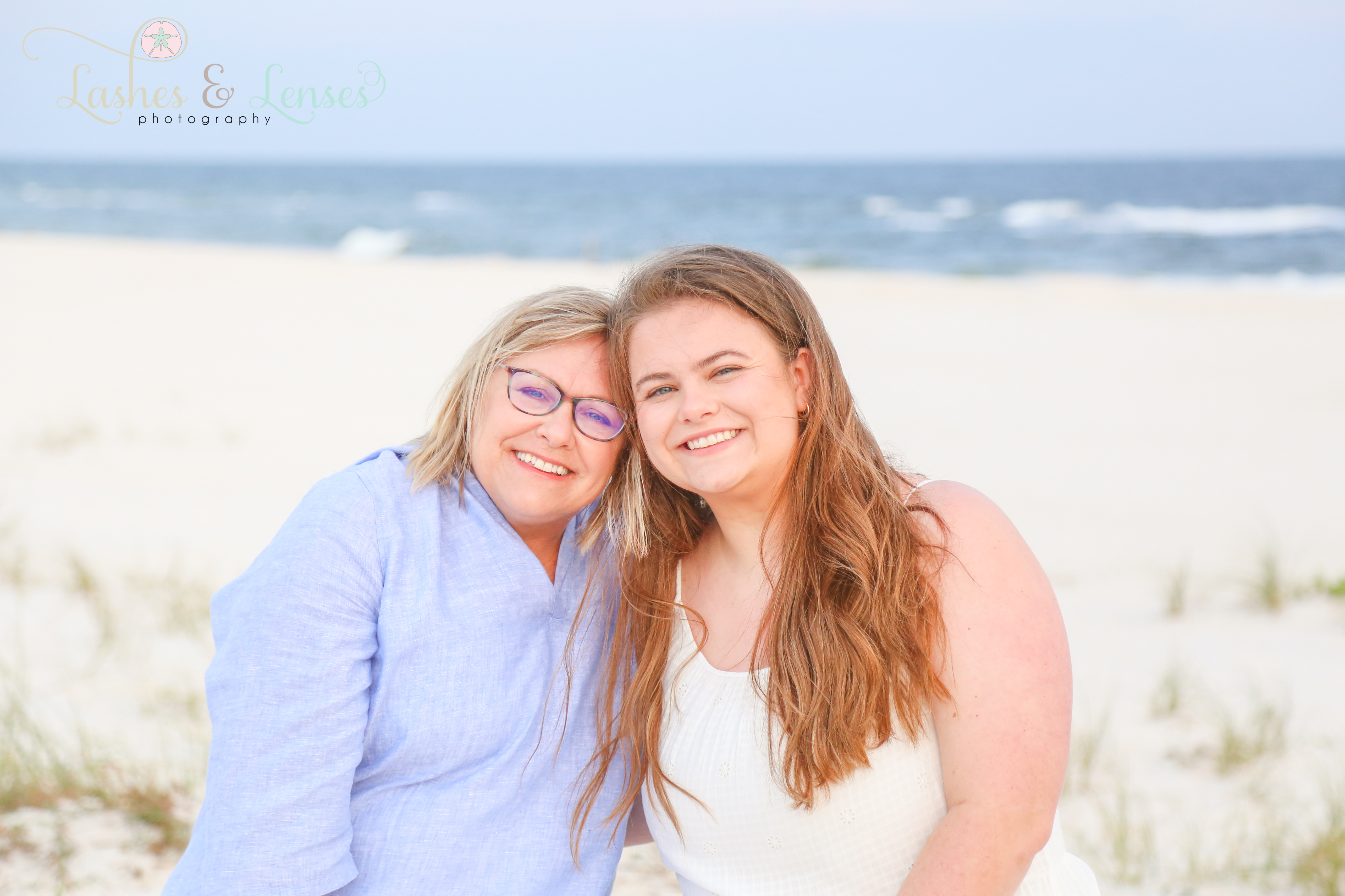 Mom and Daughter posing close together on the beach at Johnsons Beach in Perdido Key