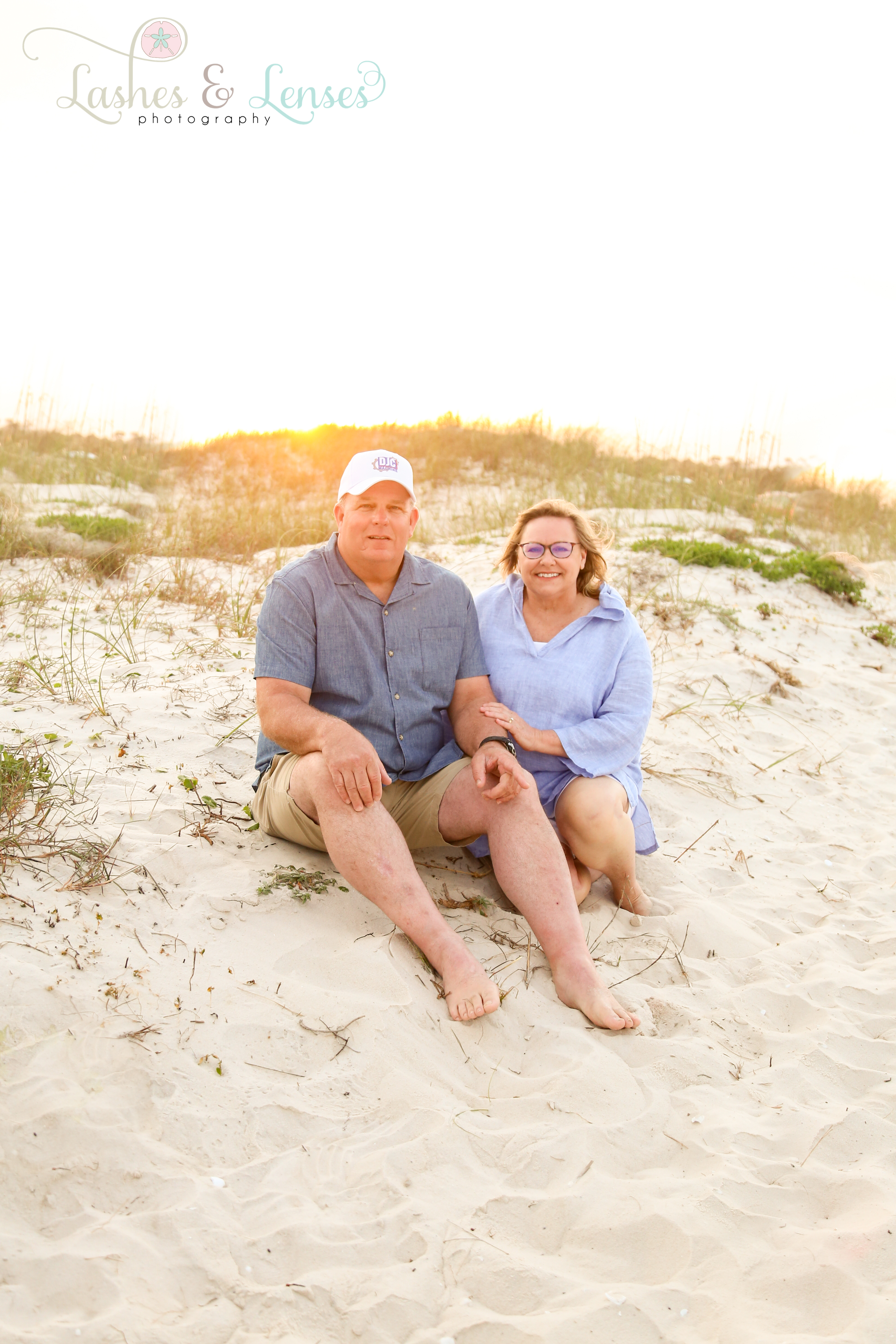 Husband and Wife sitting in the sand at Johnsons Beach in Perdido Key