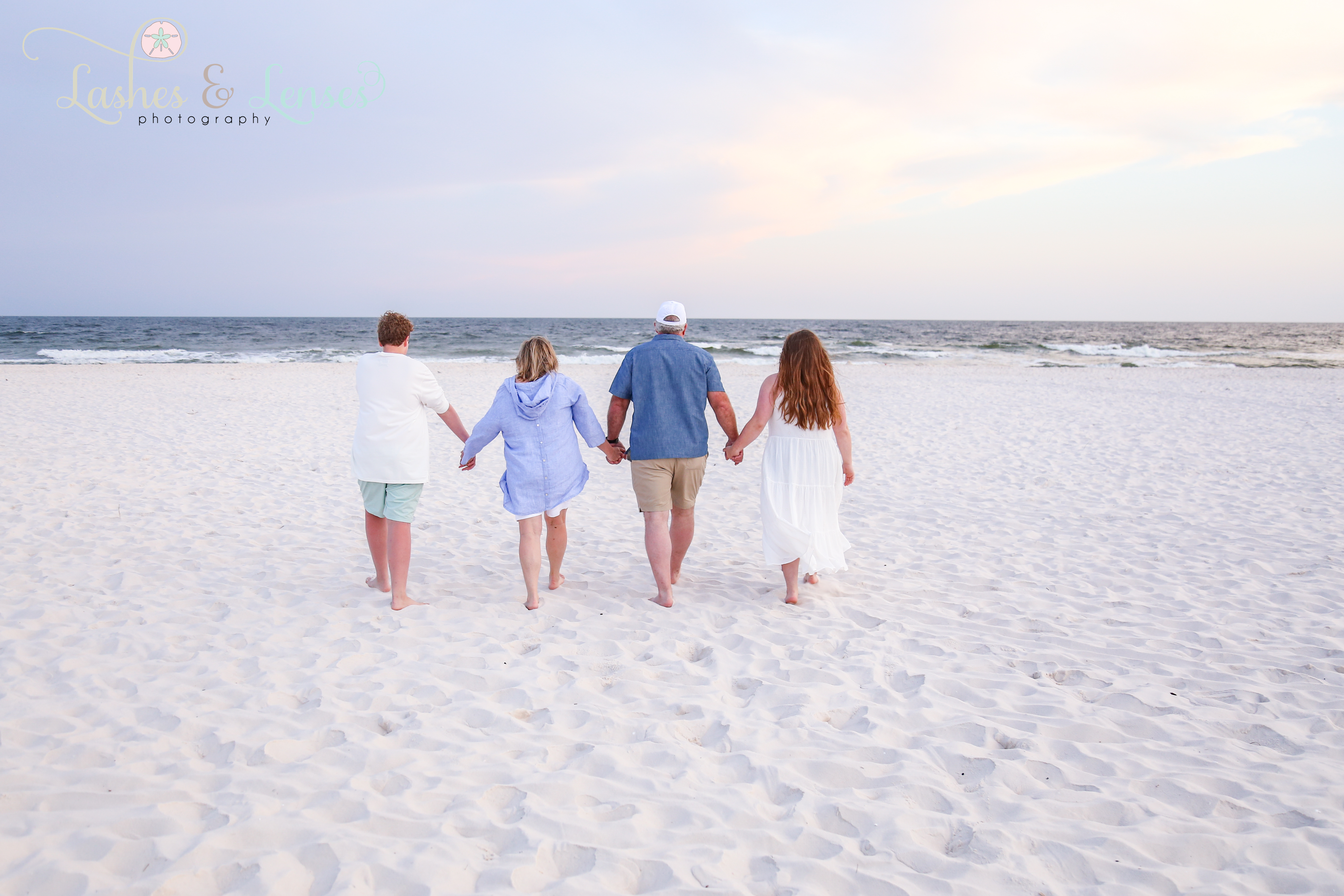 Family walking towards the water at Johnsons Beach in Perdido Key