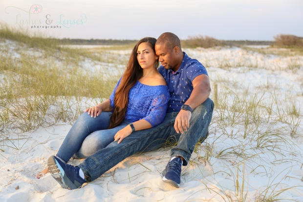 Couple sitting in the sand at Johnsons Beach in Perdido Key