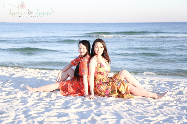Aunt and Adult Niece sitting in the sand next to the water Johnsons Beach in Perdido Key
