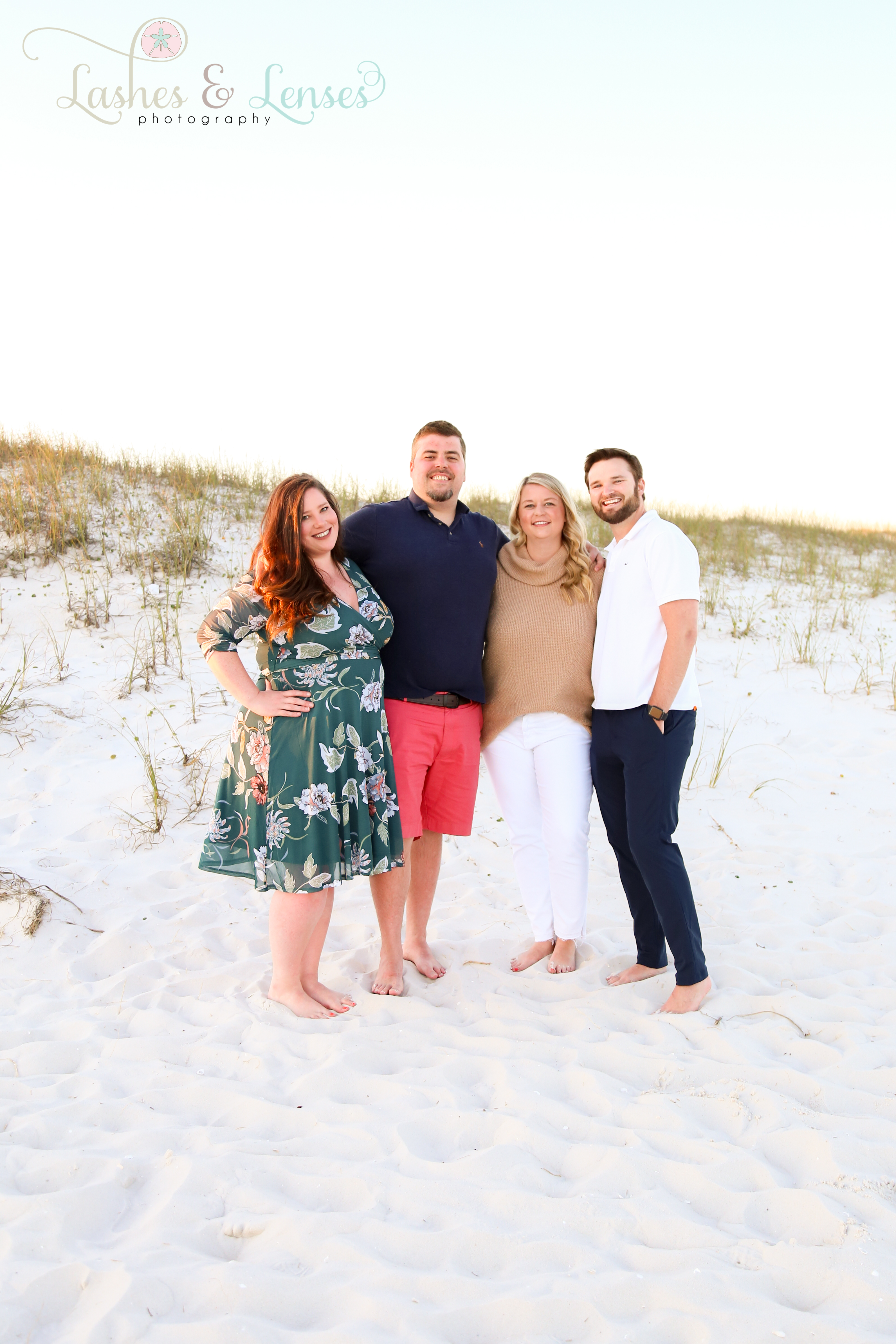 Two sets of couples standing in the sand dunes at Johnsons Beach in Perdido Key