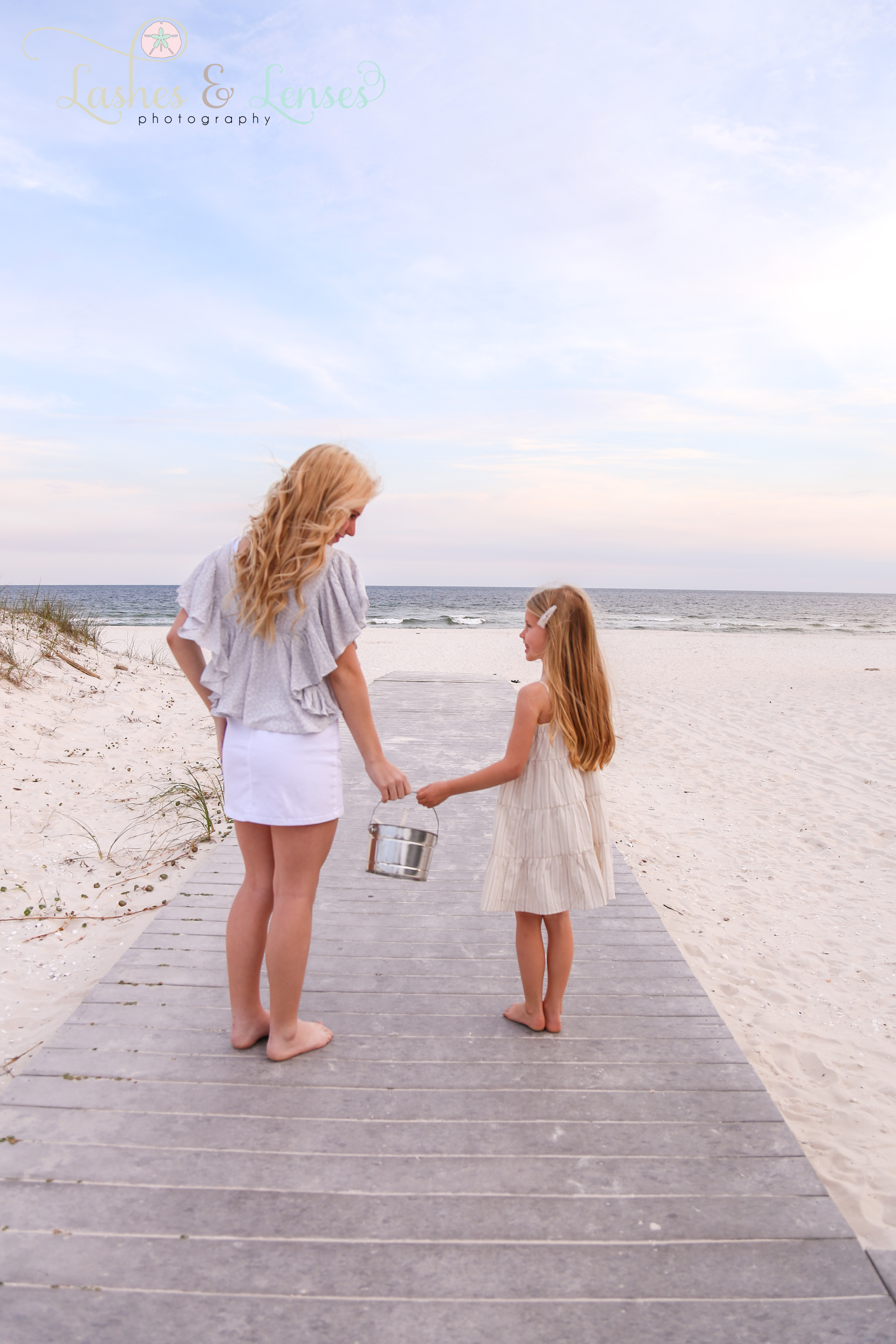 Sisters on the boardwalk at Johnsons Beach in Perdido Key