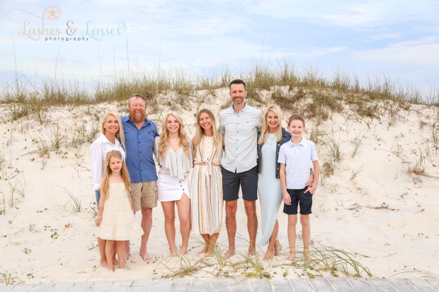 Large family standing next to the sand dunes at Johnsons Beach in Perdido Key