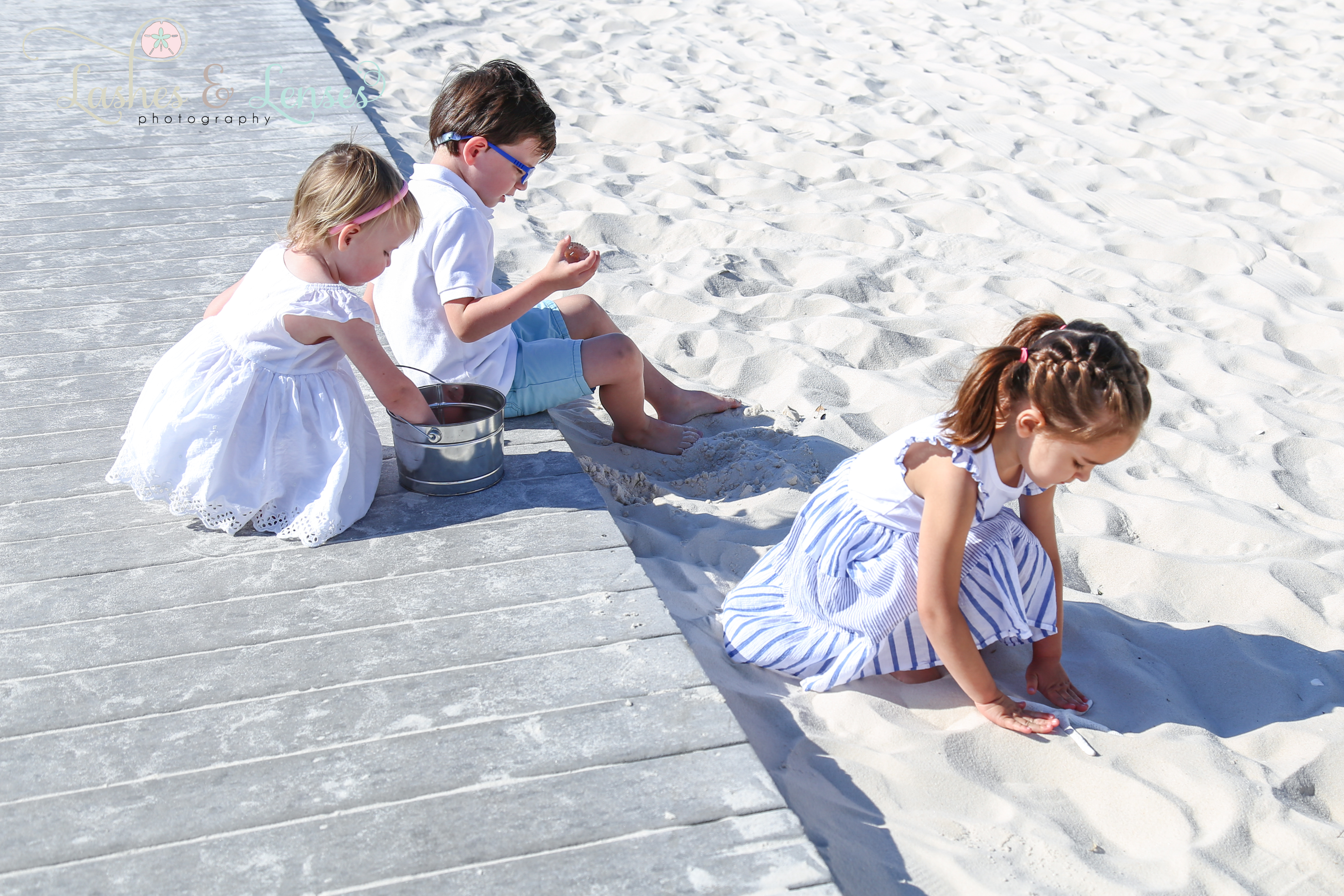 Young cousins playing in the sand at Johnsons Beach in Perdido Key