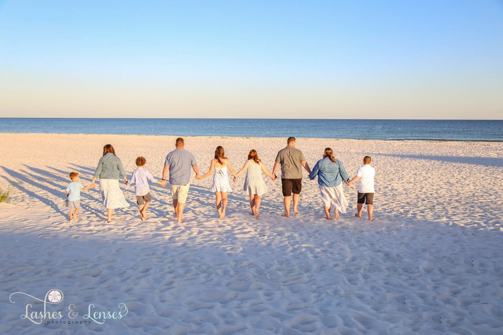 Two families walking down the beach towards the beach at Johnsons Beach in Perdido Key Florida