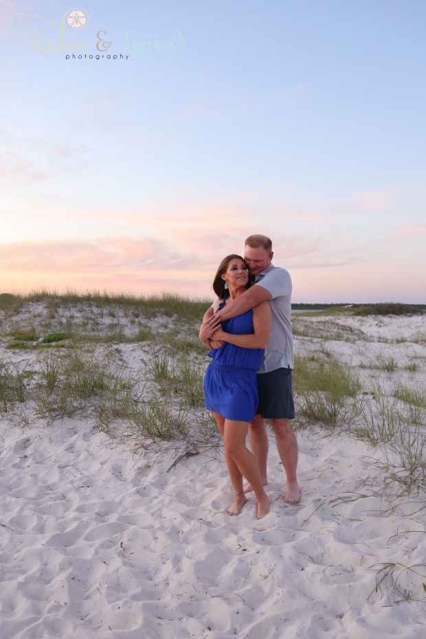 Married couple with the sunset behind them  at Johnsons Beach in Perdido Key Florida