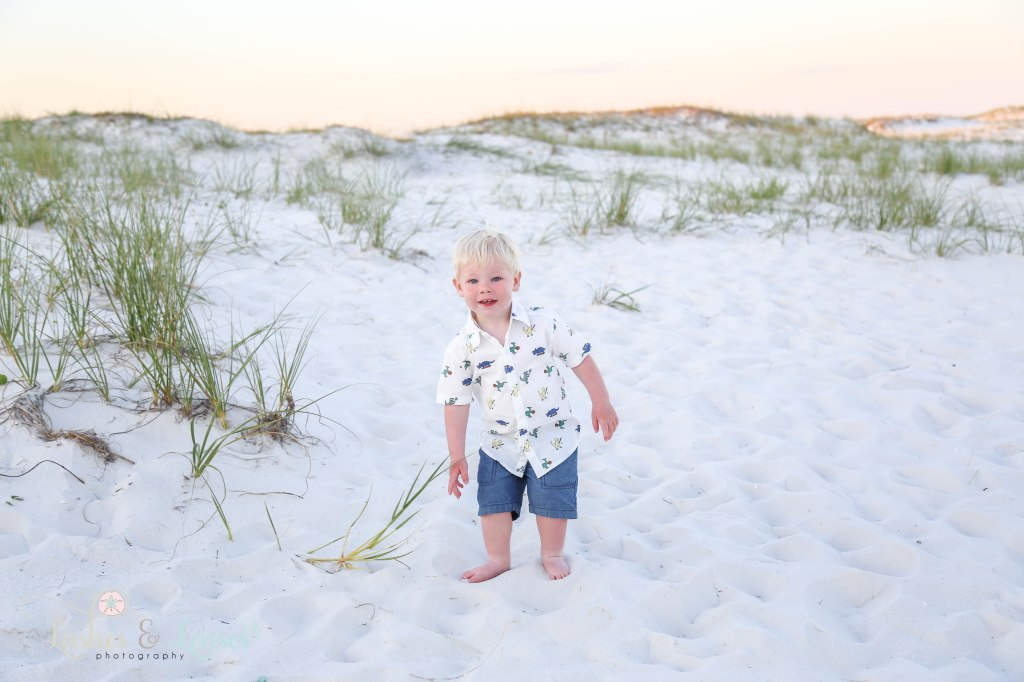 Toddler boy playing in the sand at Johnsons Beach in Perdido Key Florida