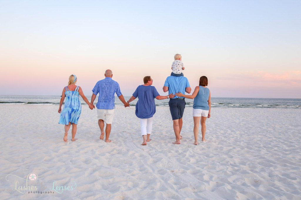 Extended family walking down to the water at Johnsons Beach in Perdido Key Florida