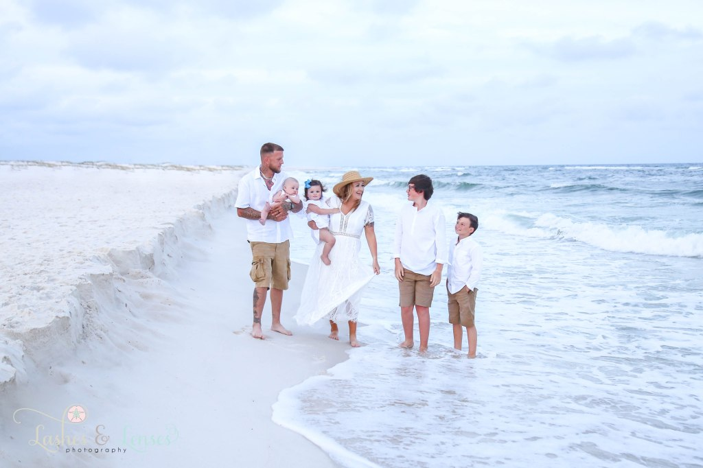 Family walking in the waves at Johnsons Beach in Perdido Key Florida