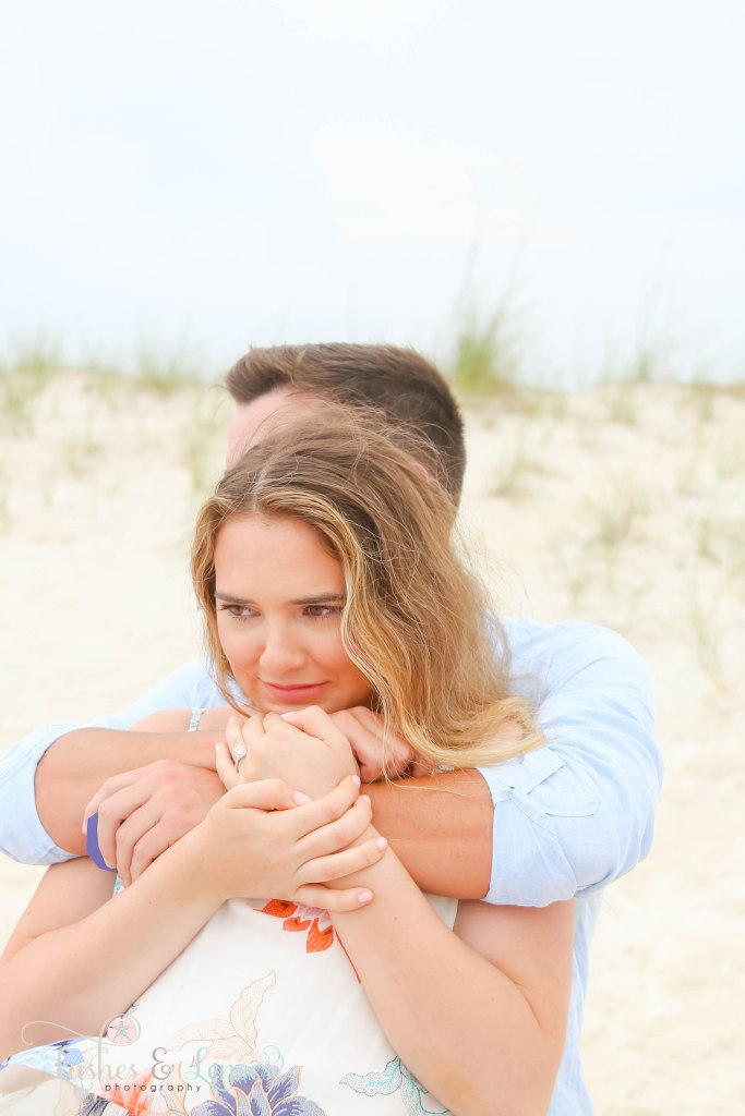 Surprise Engagement Session, close up photo of newly engaged couple hugging at Johnsons Beach in Perdido Key Florida