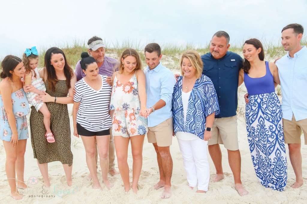 Surprise Engagement Session, whole family looking at the engaged couple at Johnsons Beach in Perdido Key Florida