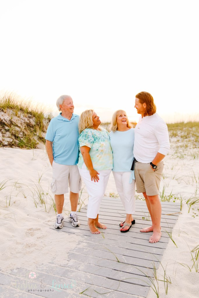 Mom and Dad with their adult son and daughter at Johnsons Beach in Perdido Key Florida