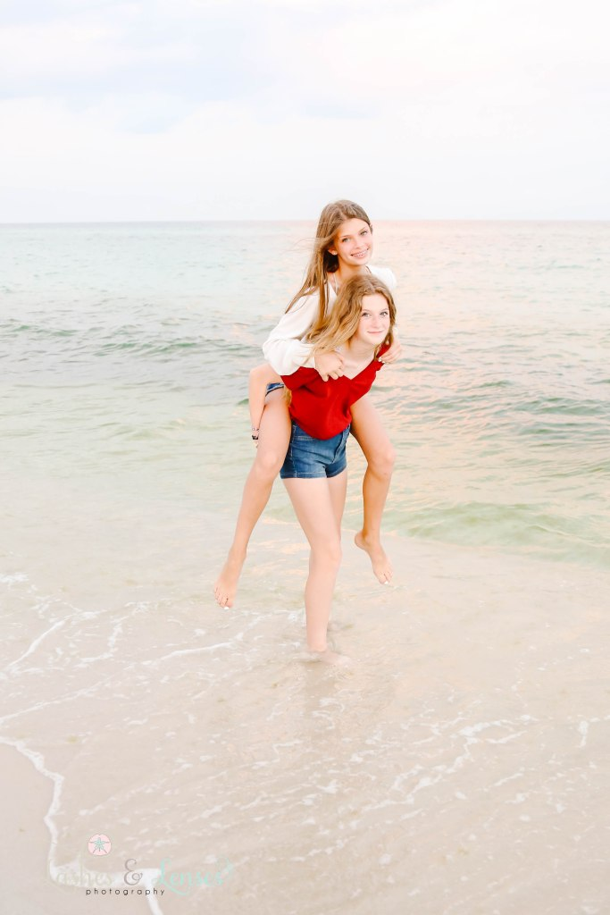 Teen best friends down by the water at Johnsons Beach in Perdido Key Florida