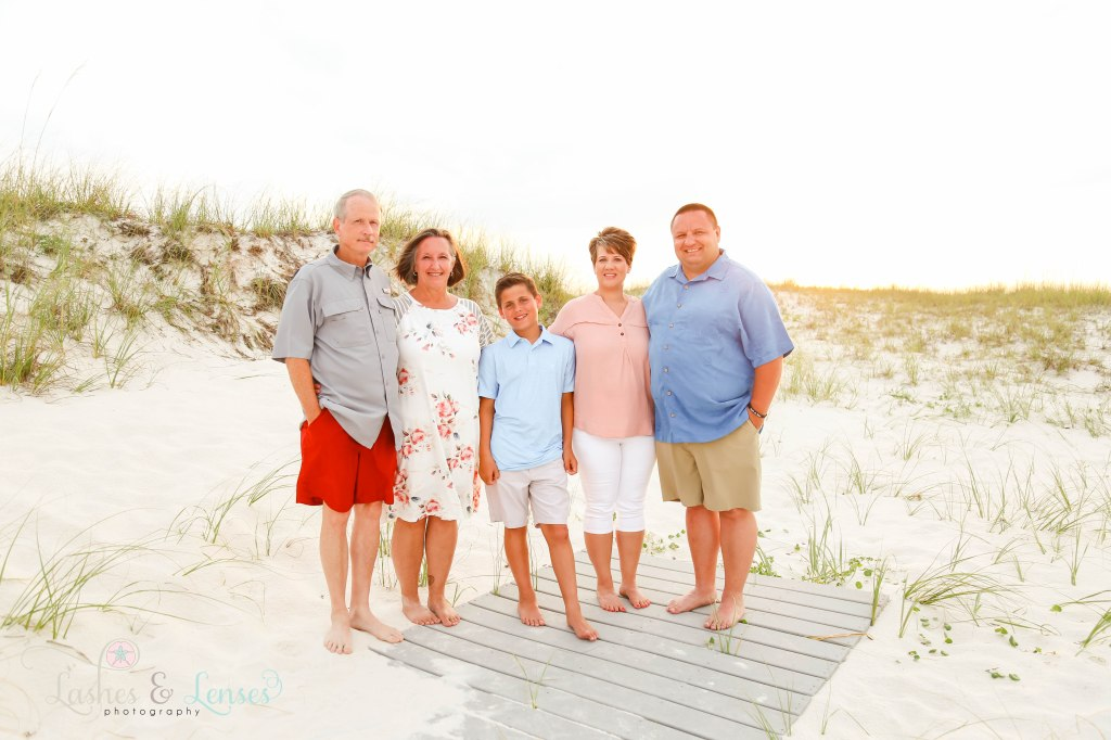 Grandma, new husband and her son and his wife and grandson all standing on the boardwalk at Johnsons Beach in Perdido Key Florida