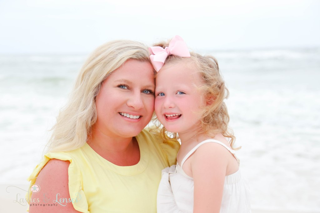 Close up photo of Mom and kindergarten age daughter at Johnsons Beach in Perdido Key Florida