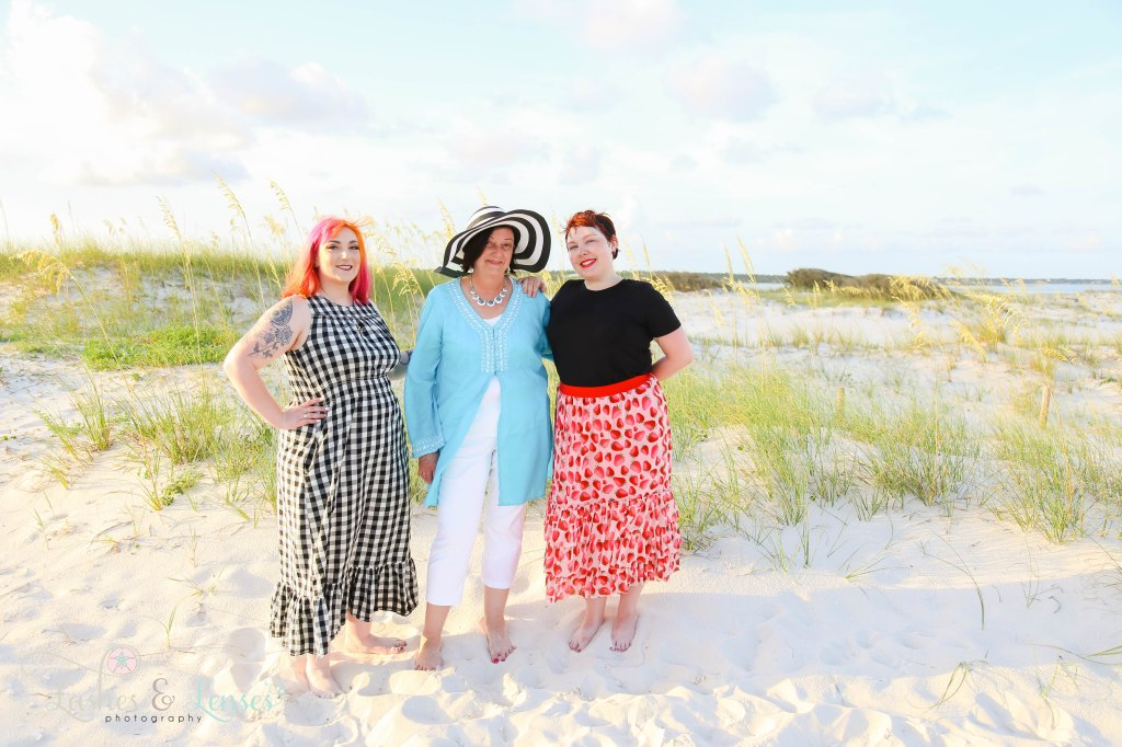 Mom and her two step daughters standing next to the sand dunes at Johnsons Beach in Perdido Key Florida