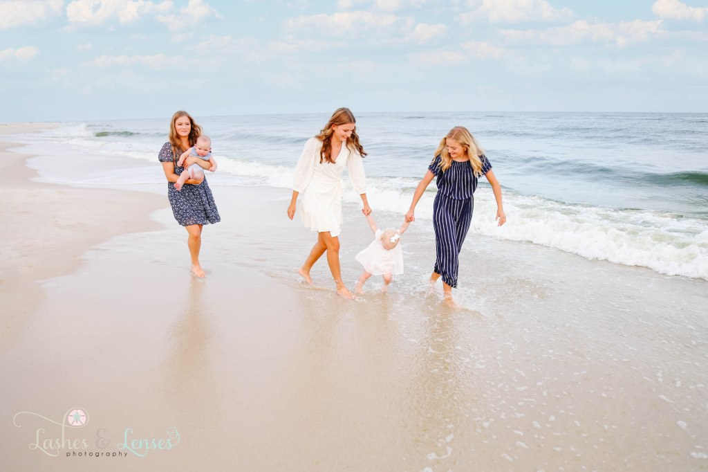 Triplet Aunts playing in the water with their niece and nephew in the water at Johnsons Beach in Perdido Key Florida