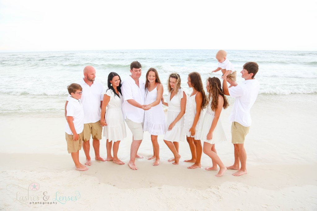 Whole extended family admiring the ring down by the water at Johnsons Beach in Perdido Key Florida