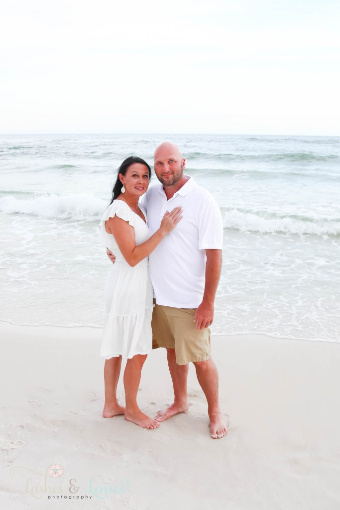 Husband and wife down by the waters edge at Johnsons Beach in Perdido Key Florida