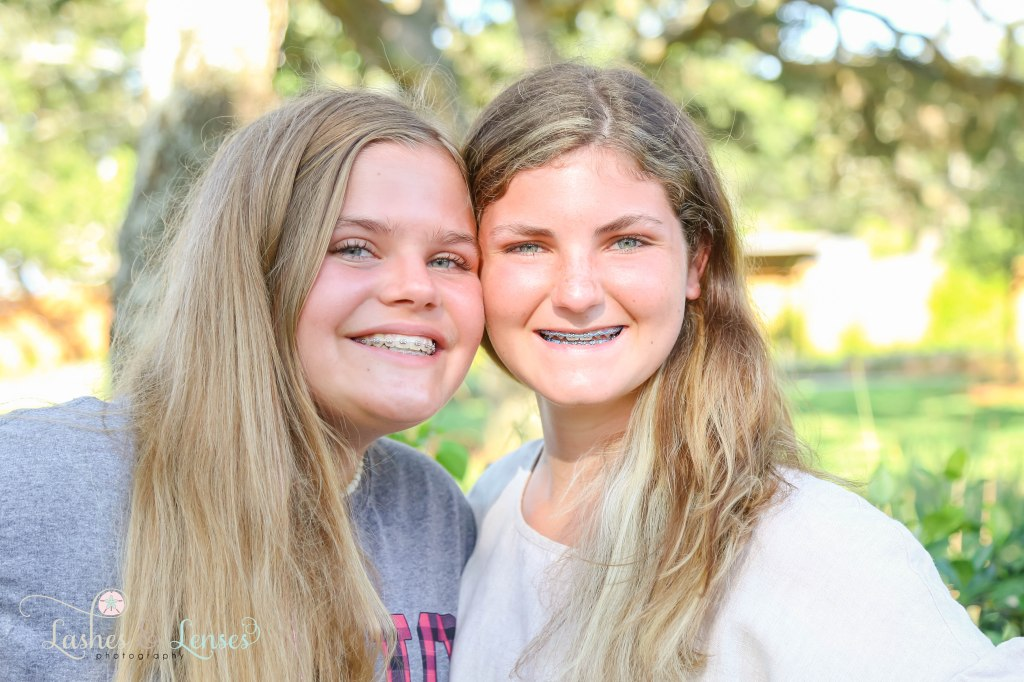 Close up of teen girl best friends at Innerarity Point Park in Pensacola, Florida