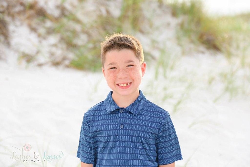 Close up photo of elementary age boy at Johnsons Beach in Perdido Key Florida