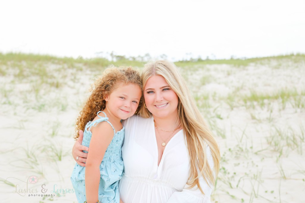 Close up of young mom and toddler daughter at Johnsons Beach in Perdido Key Florida