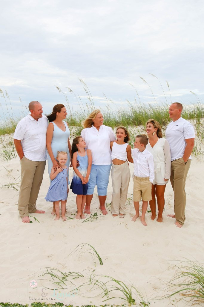 Extended family standing in front of the sand dunes at Johnsons Beach in Perdido Key Florida