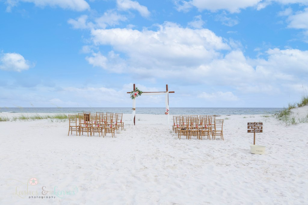 Wedding Arch and chairs set up at Johnsons Beach in Perdido Key Florida