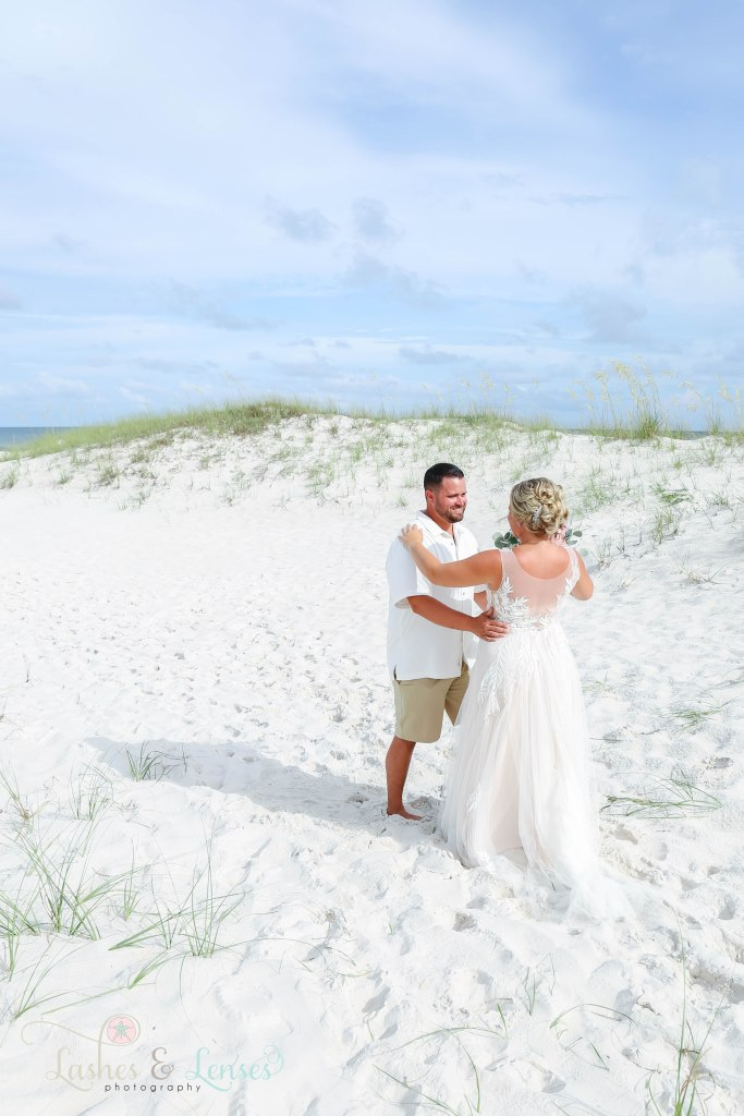 Groom and Bride seeing each other for the first time on their wedding day at Johnsons Beach in Perdido Key Florida