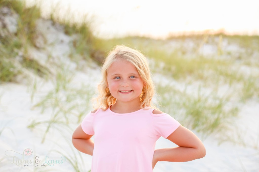 Close up photo of blonde little girl at Johnsons Beach in Perdido Key Florida