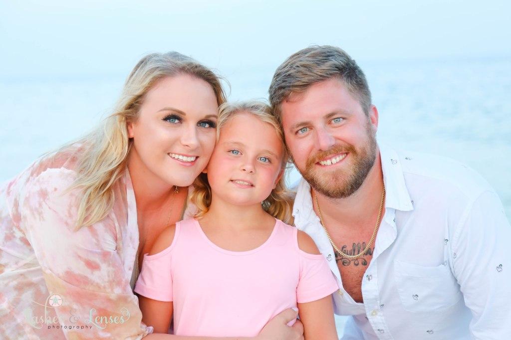 Close up photo of mom, dad and daughter at Johnsons Beach in Perdido Key Florida