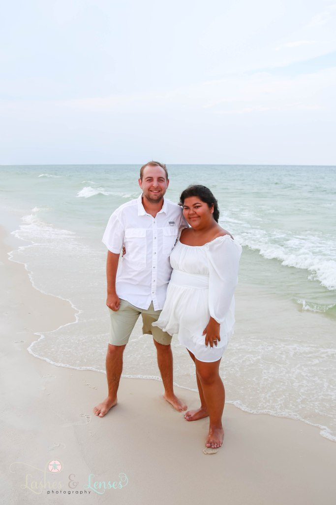 Teen best friends, a boy and a girl, standing by the waters edge at Johnsons Beach in Perdido Key Florida