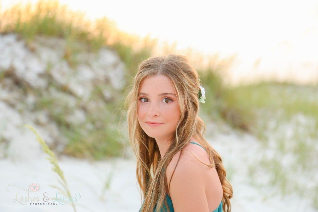 Close up photo of teen girl with beautiful brown eyes and flowing hair at Johnsons Beach in Perdido Key Florida