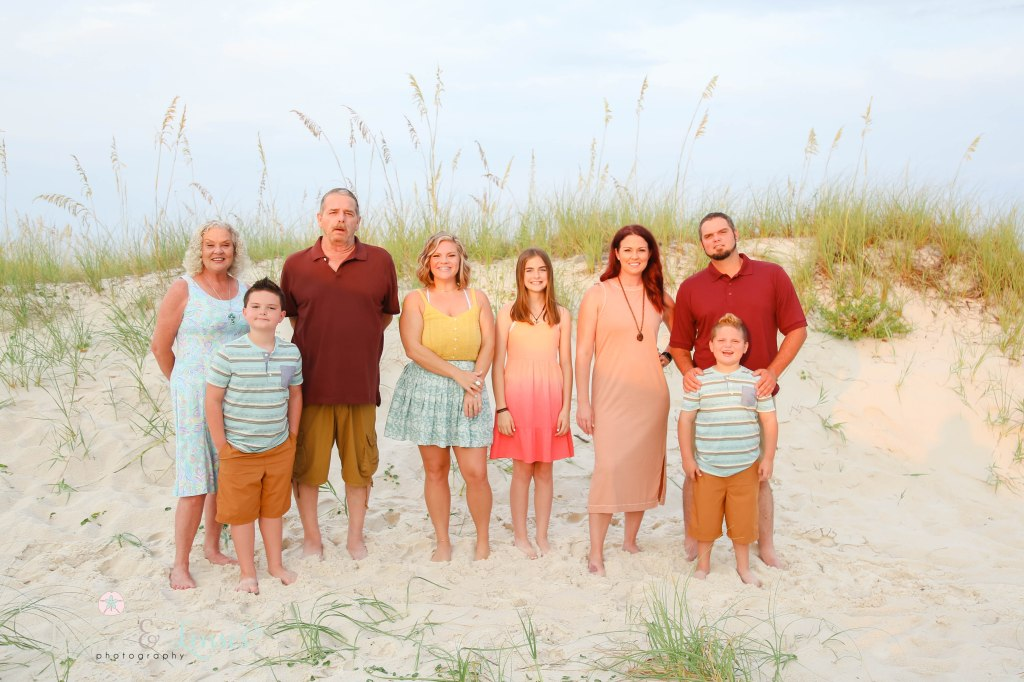 Extended Family standing by the sand dune at Johnsons Beach in Perdido Key Florida