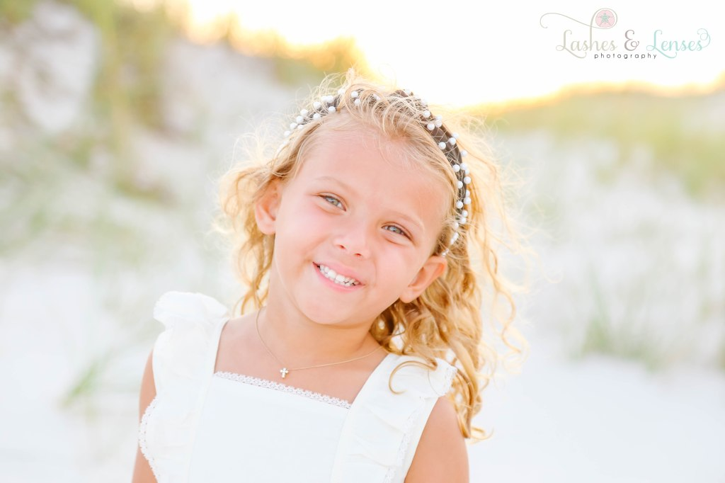 Close up photo of little girl with pearl headband at Johnsons Beach in Perdido Key Florida