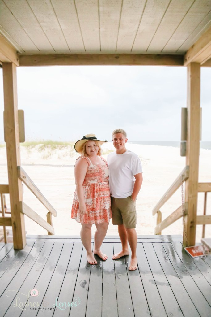 Couple standing in the pavilion, the wife is wearing a large sun hat at Johnsons Beach in Perdido Key Florida
