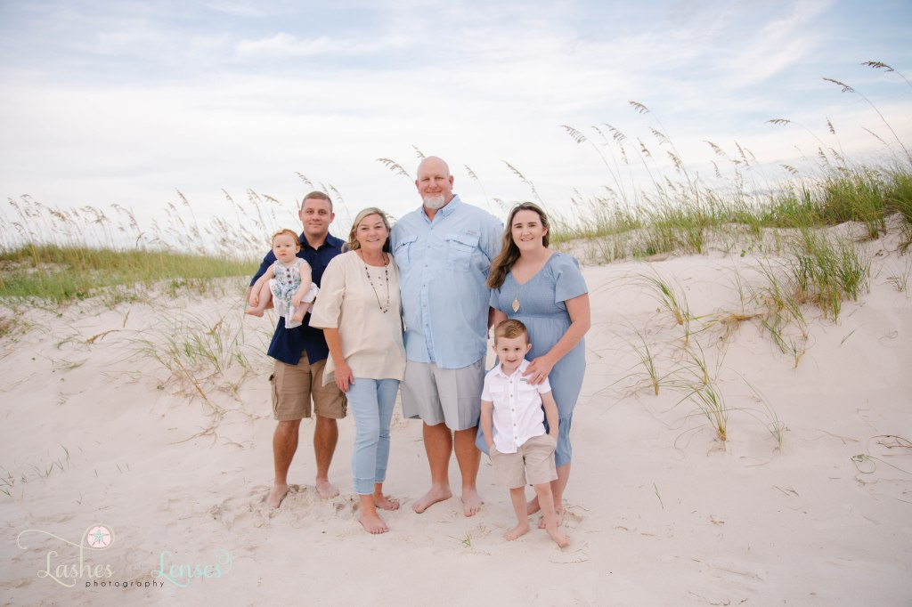 Grandparents, Mom and Dad and toddler boy and 1 year old girl at Johnsons Beach in Perdido Key Florida